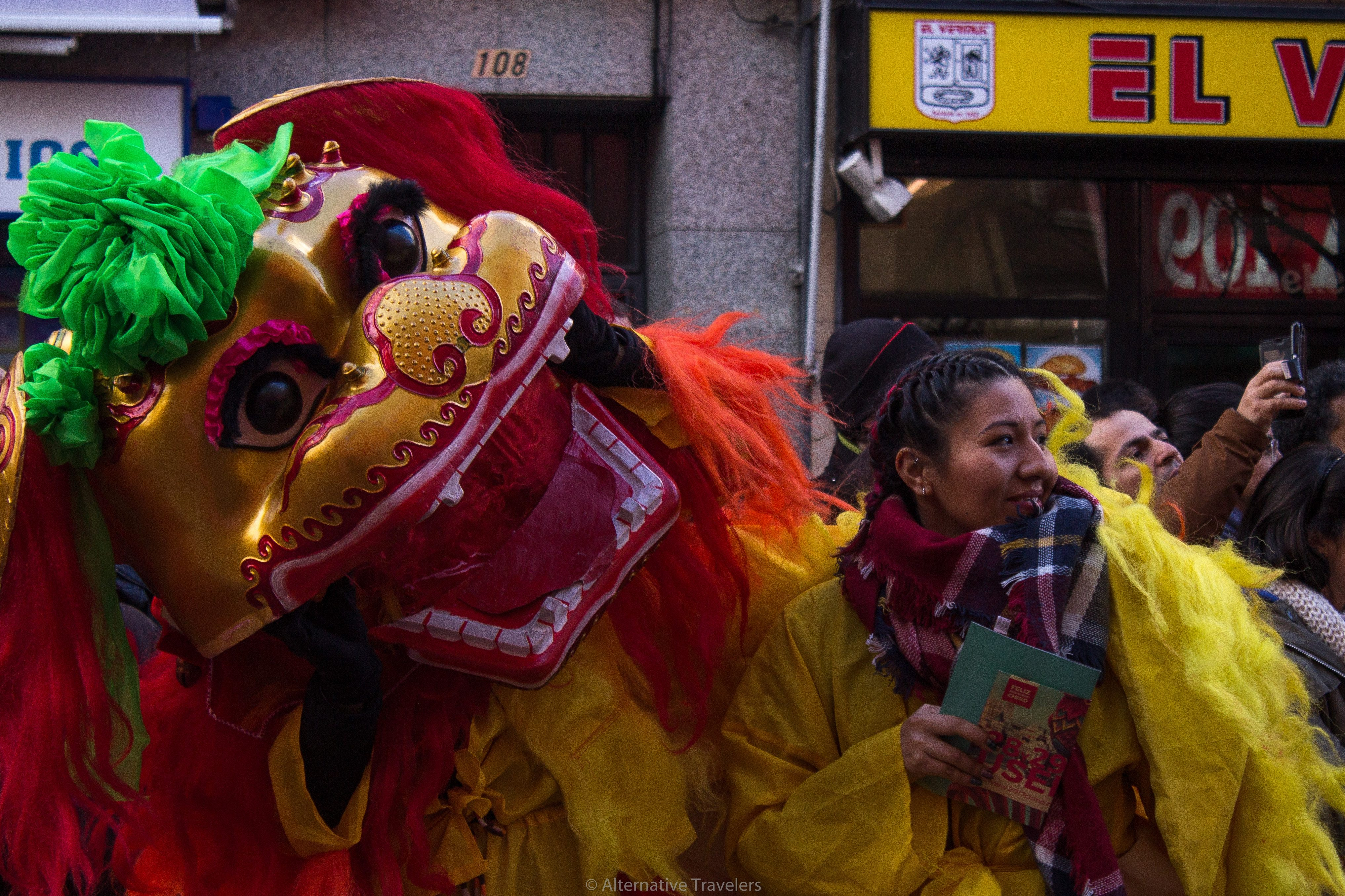 Dragon head and girl at Chinese New Year Parade in Usera, Madrid's Chinatown