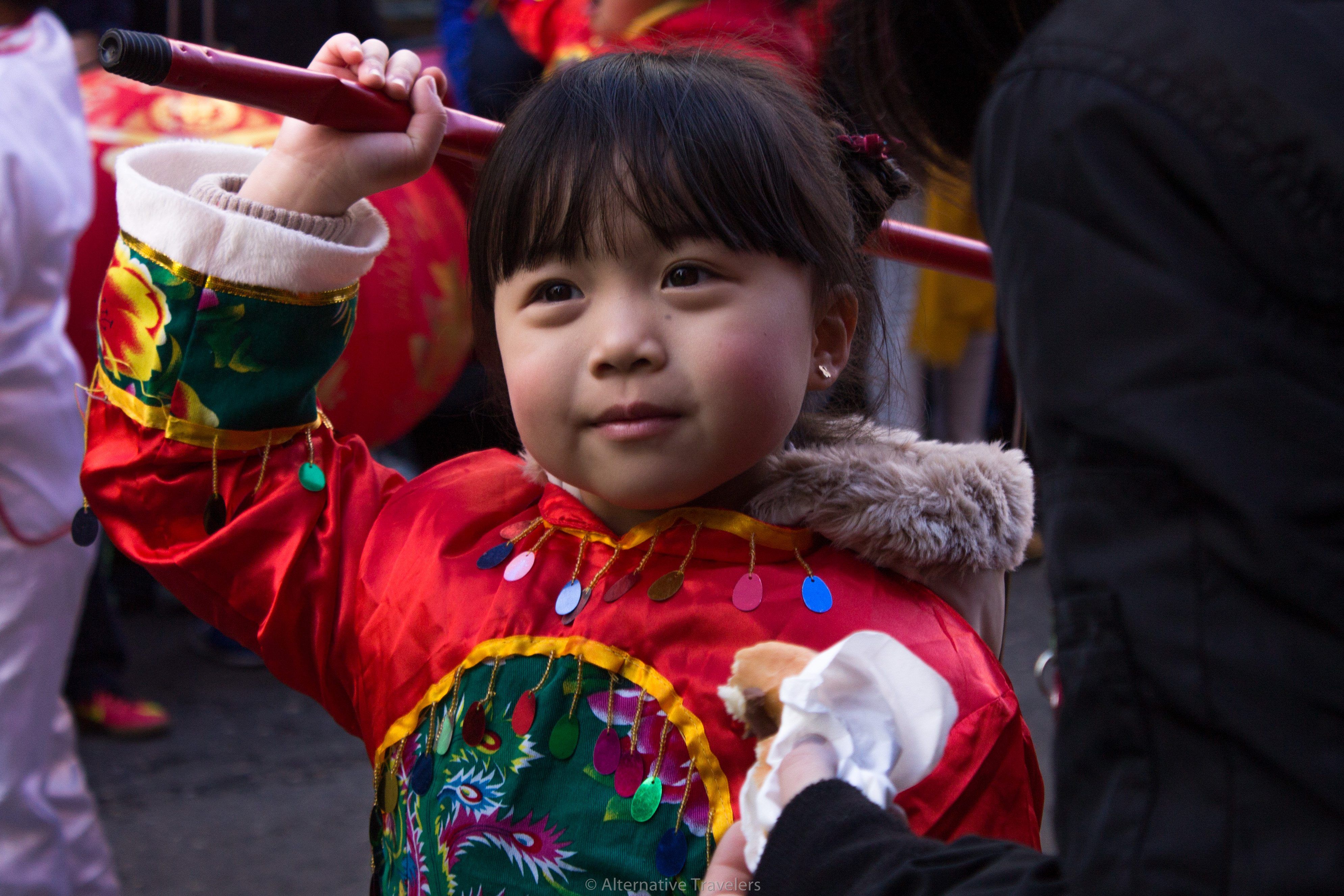 A young girl dressed up in the Chinese New Year parade in Madrid