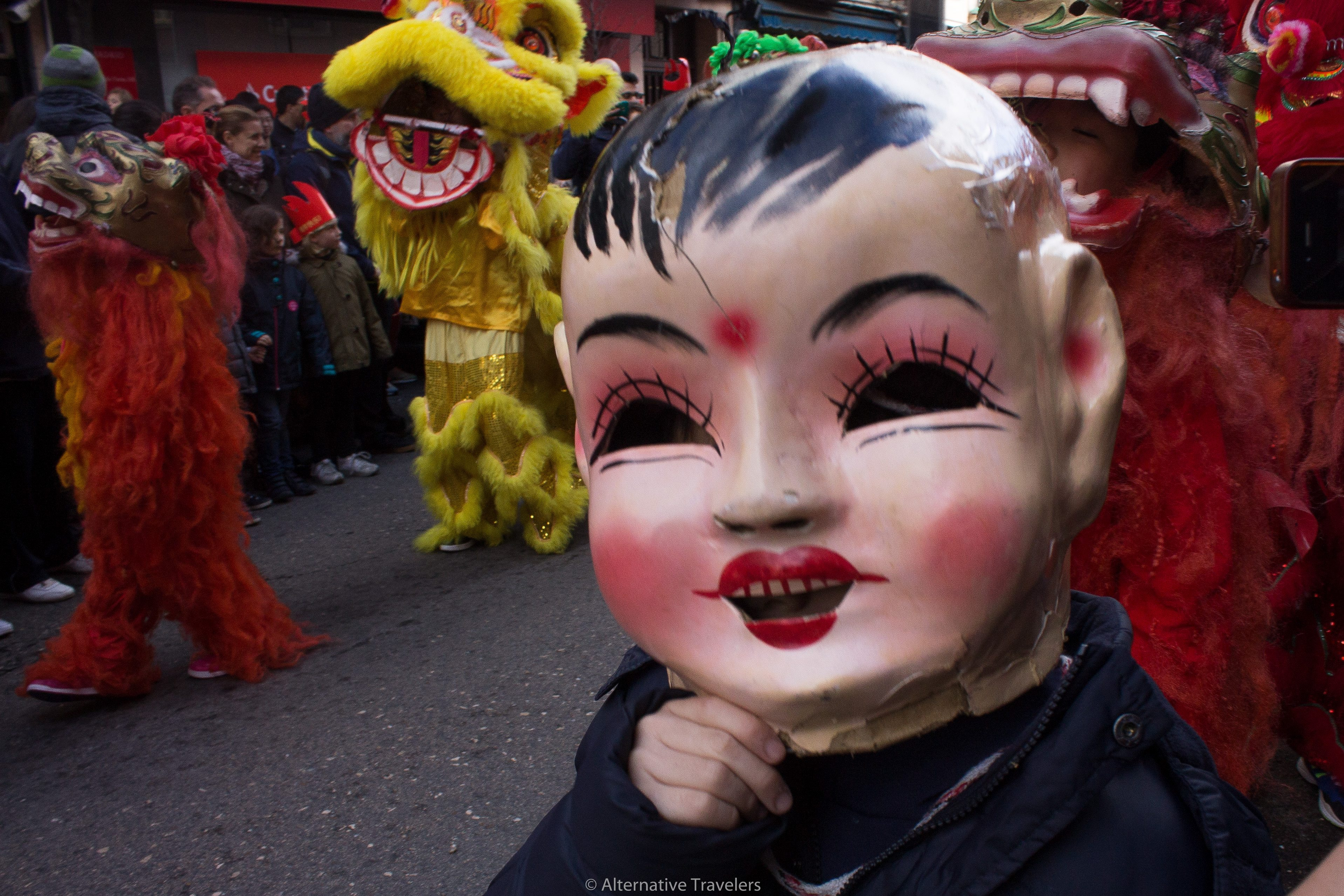 Child in mask at Chinese New Year in Madrid parade