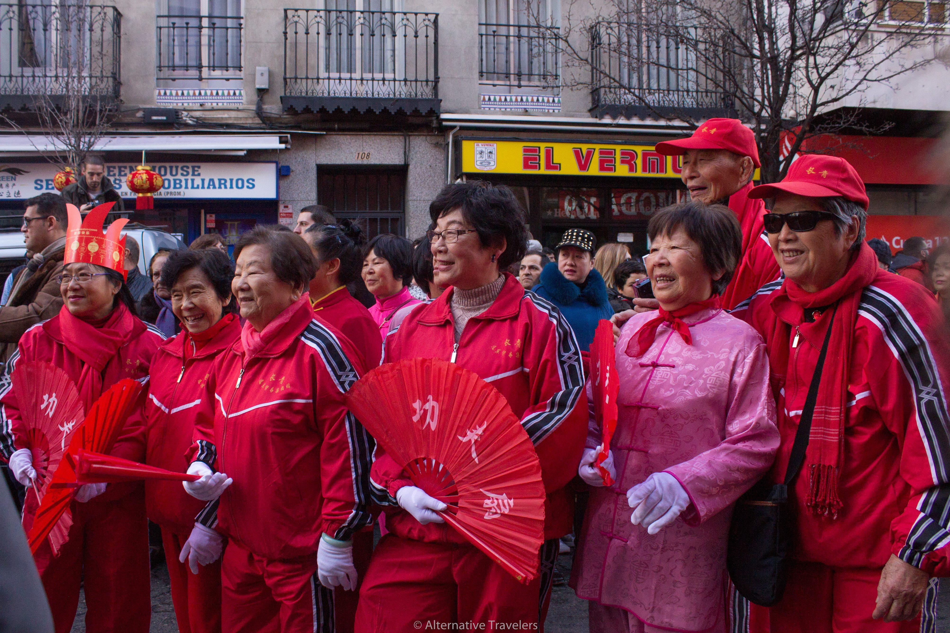 A group of elderly people pose for a photo at the chinese new year in Madrid