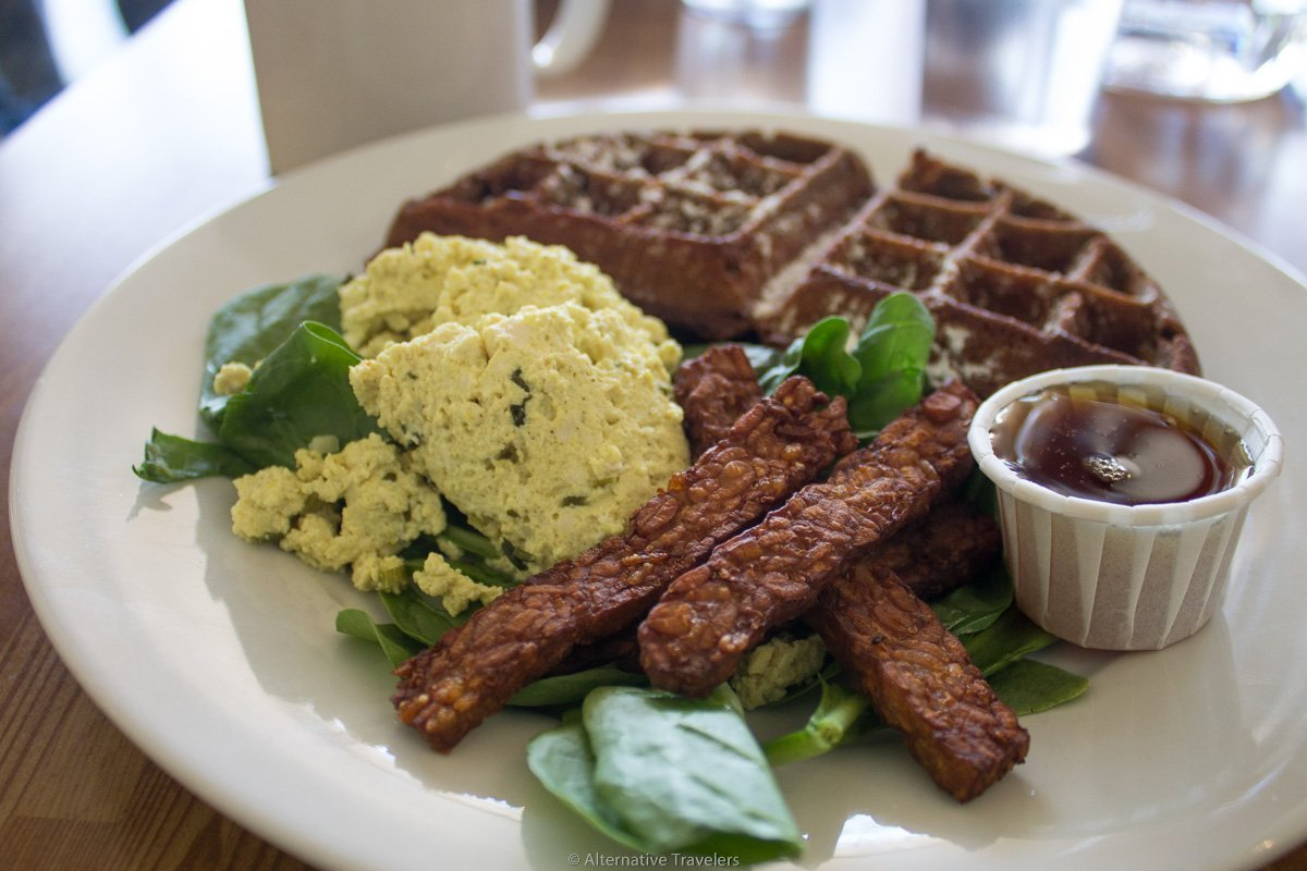 plate of vegan waffles, tempeh bacon, and tofu scramble at Off the Griddle in Portland.
