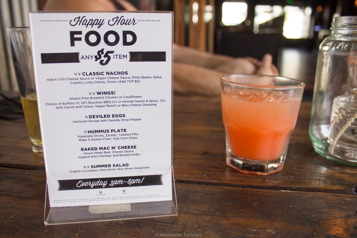Photo of happy hour menu and drink at White Owl Social Club in Portland.