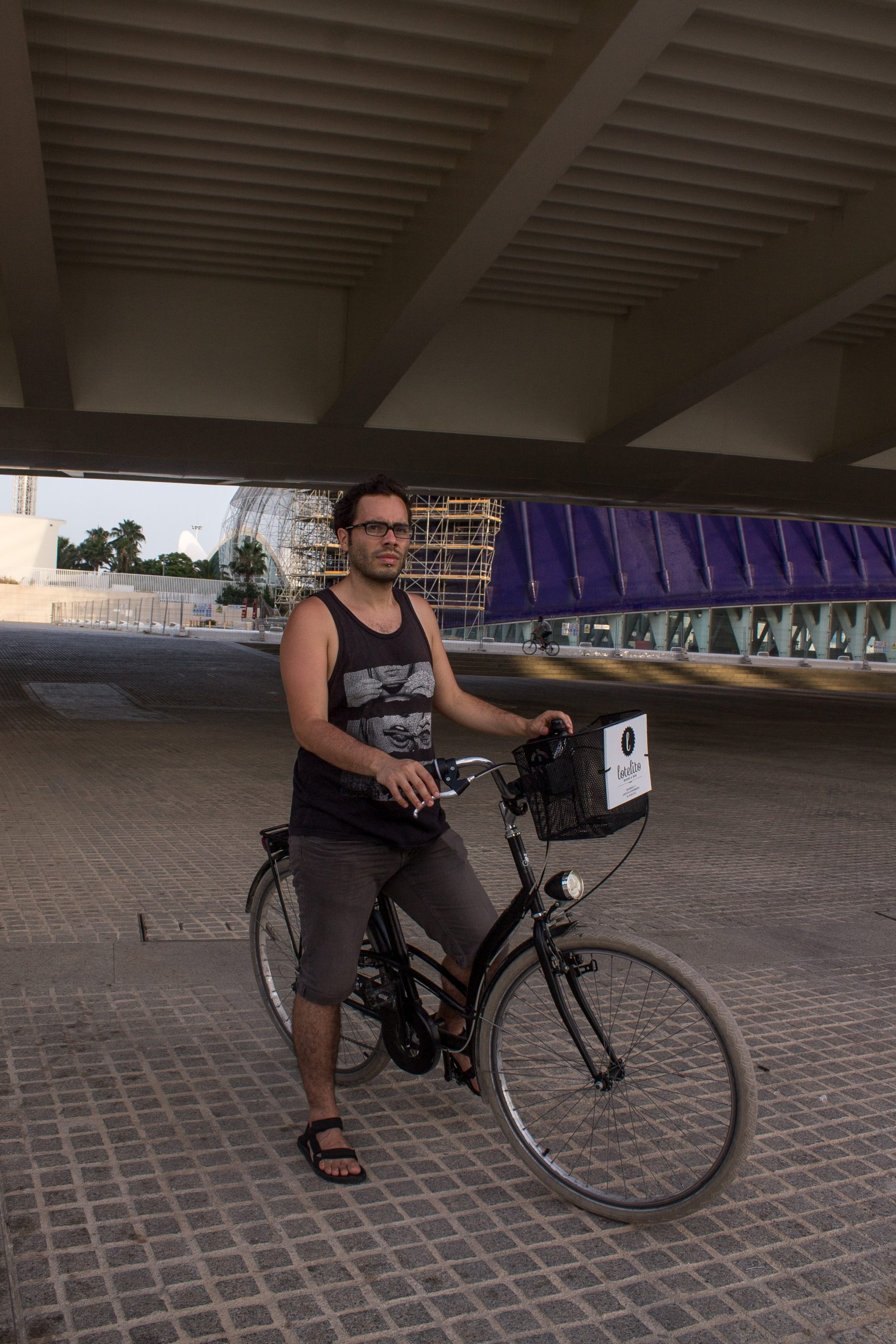 man standing with bike