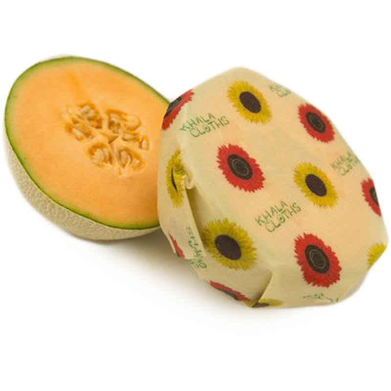 vegan food wrap from Khala Cloths, covering a cantaloupe