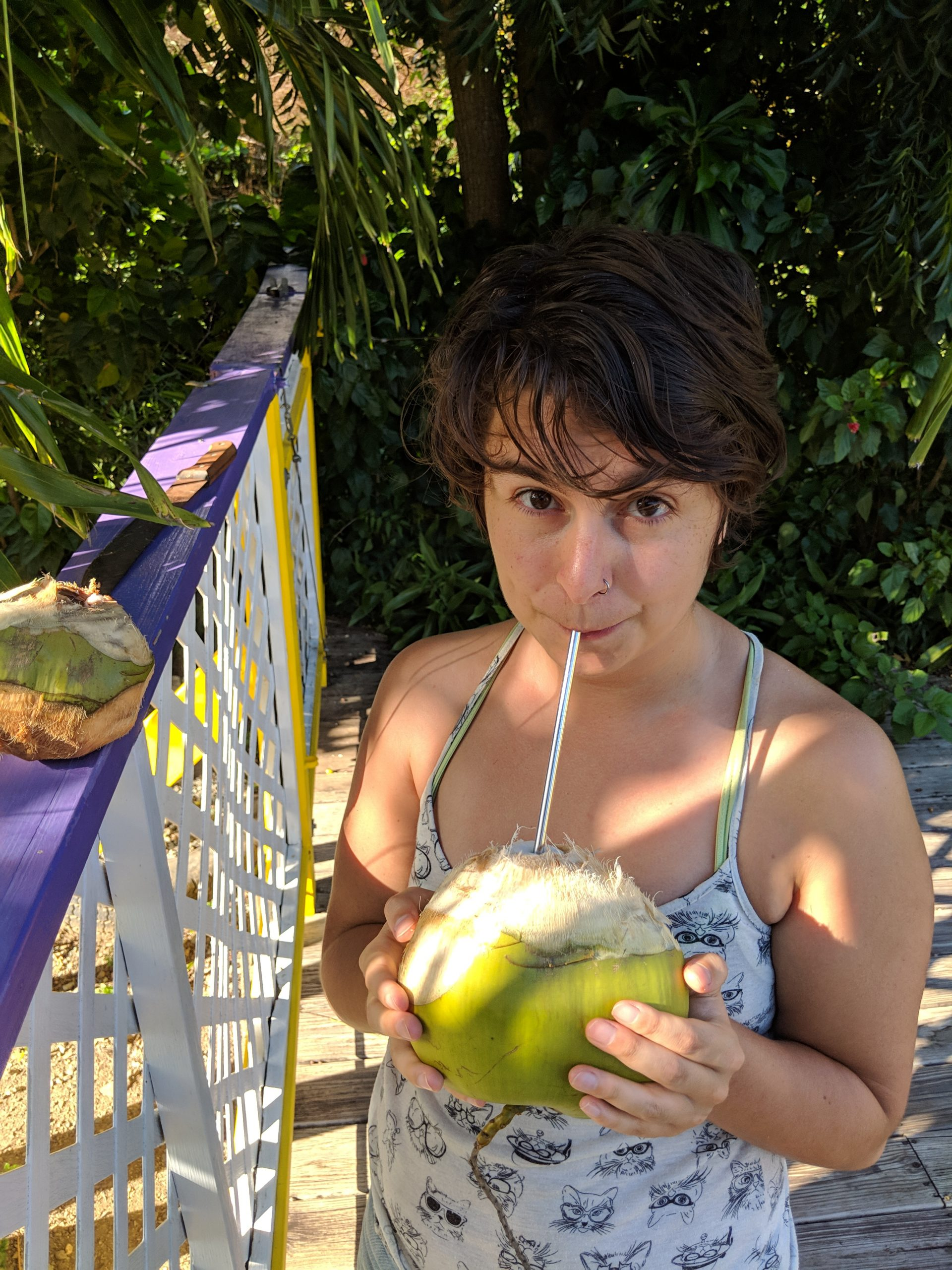 girl with reusable straw in a coconut